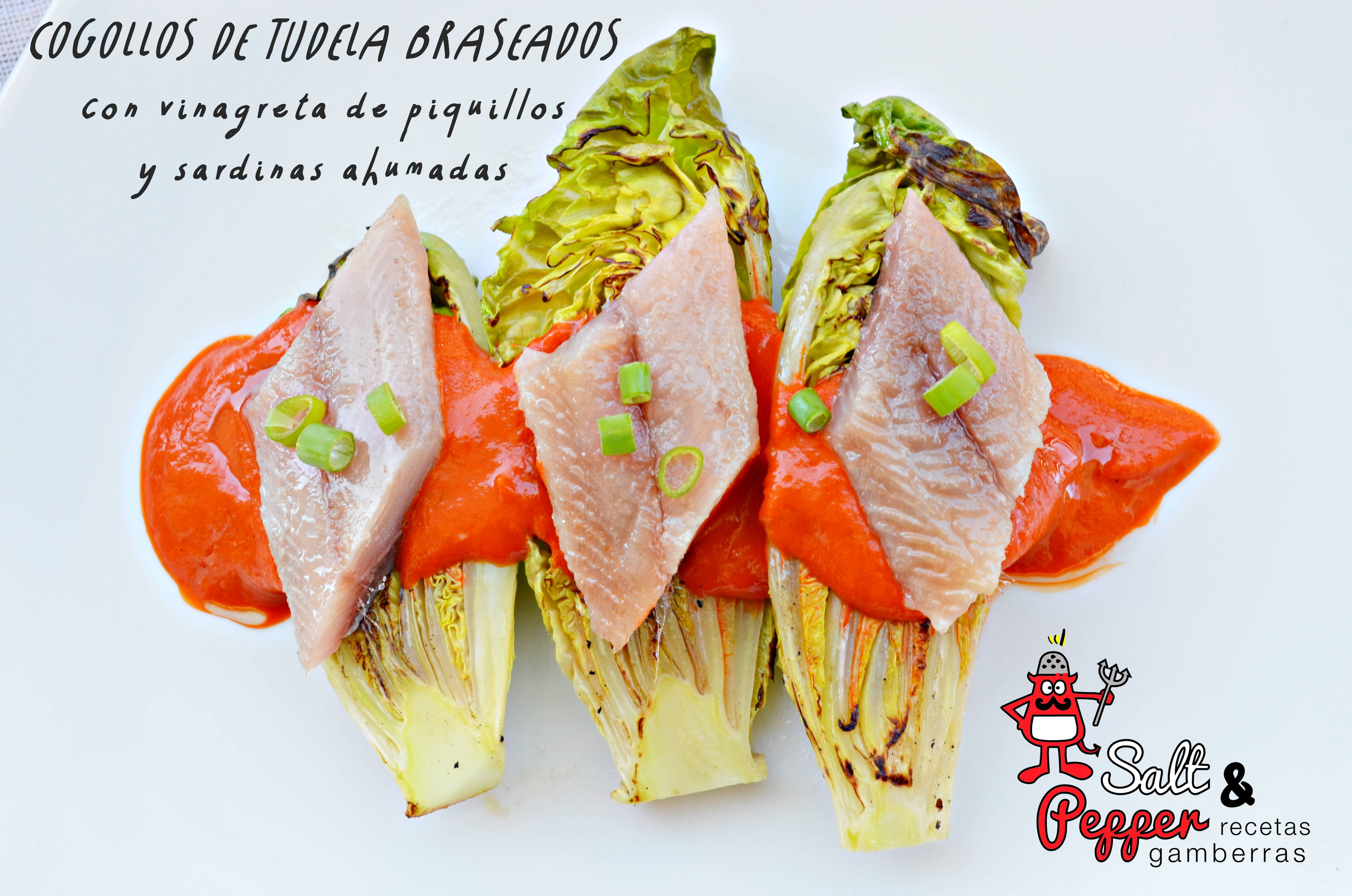 Platos de cogollos de Tudela braseados, cubiertos por una vinagreta de pimientos del piquillo y terminados con una sardina ahumada.